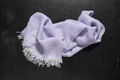Lavender Hand Towel with White Fringes on Dark Surface Stock Photos