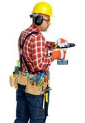 Builder handyman with drill. - stock photo