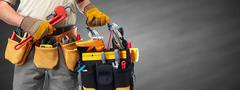 Builder handyman with construction tools. Stock Photos