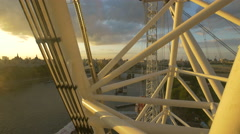 River Thames seen between the London Eye's spokes Stock Footage