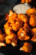 Spicy Breaded Buffalo Chicken Cauliflower Stock Photos