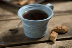 Blue Cup Containing Coffee or Tea with Spoon and Biscuits - stock photo