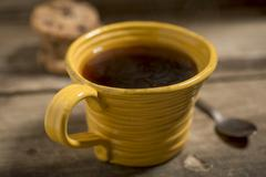 Yellow Cup Containing Warm Coffee or Tea Stock Photos