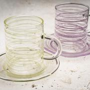 Close Up of Pair of Crystal Cups with Matching Saucers Stock Photos