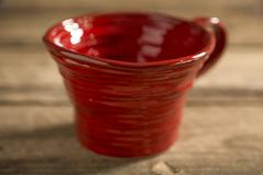Close Up of Red Teacup on a Wooden Surface Stock Photos