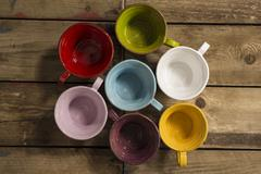 High Angle Shot of Seven Teacups of Various Colors Stock Photos