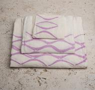 Stack of Towels with Purple Concave Lines at High Angle Stock Photos