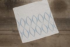 Square Table Napkin with Blue Concave Lines Design Stock Photos