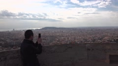 Man take panoramic picture of Barcelona from top point. POV camera move Stock Footage