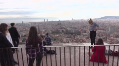 Young people enjoy panoramic city views, rest, take pictures, pose Stock Footage