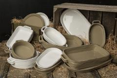 A Collection of White and Tan-Colored Earthenware with Dried Grass Stock Photos