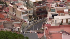 Empty local road at dense built area, Barcelona suburb telephoto view Stock Footage