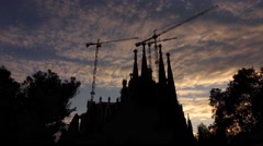 Sagrada Familia towers silhouette against evening sky, slide motion shot Stock Footage