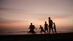 Boys playing games on beach Stock Footage