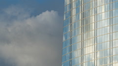 Afternoon clouds reflected in skyscraper windows HD Stock Footage