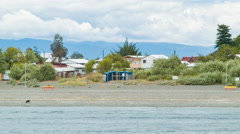 Local Neighborhood Homes Along the Shores at Puerto Montt Chile Stock Footage