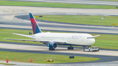 Boeing 767 of Delta Airlines Towed on Taxiway Stock Footage