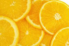 Slice of an orange Stock Photos
