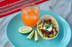 Mexican food Taco boat Tortilla served with Margarita and lime - stock photo