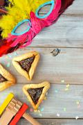 Flat lay of Purim Jewish holiday food and objects - stock photo