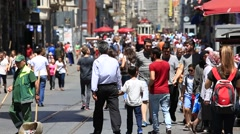 People walk through one of the busiest shopping streets in Istanbul , Turkey Stock Footage