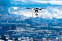 Ulan-Ude, Russia - March 5, 2016: Hovering drone that takes pictures Stock Photos