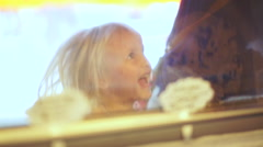 Stock Video Footage of Little Girl Jumps Up And Down, With Excitement, At Ice Cream Shop