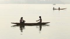 Local people in small boat for transportation in the lake of Srinagar, India - stock footage
