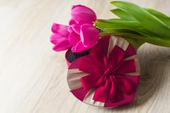 Three purple tulip and a box for gift Stock Photos