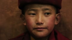 Buddhist young monk during Hemis Festival at Ladakh, North India. Close up Stock Footage