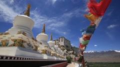 Buddhist prayer flags and tibetan Stupa at Thiksey monastery. Leh, Ladakh, India Stock Footage