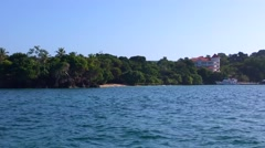 Coast view with a premium hotel, taken from a boat, at cayo levantado, samana - stock footage