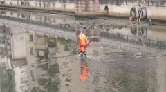 Sanitation workers clean up the river rubbish Stock Footage