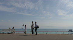 Tourists walking on the promenade on a sunny day in Nice Stock Footage
