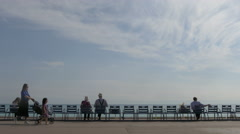 Sitting on blue chairs along Promenade des Anglais in Nice - stock footage