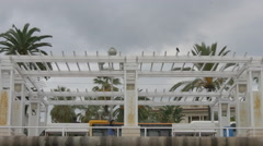 Driving by a white wooden sunshade construction on Promenade des Anglais, Nice Stock Footage