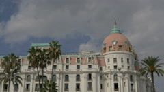 Le Negresco Hotel on a cloudy day in Nice - stock footage