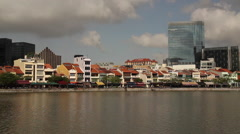 View of Boat Quay Singapore from across Singapore River Stock Footage