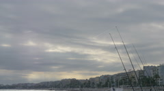 Stock Video Footage of Many fishing rods fixed on the beach in Nice