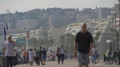 People walking by HI-beach on Nice's famous Promenade des Anglais, Nice Stock Footage