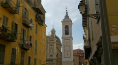 A bell tower and the Cathédrale Sainte-Réparate seen from Rue Rossetti, Nice Stock Footage