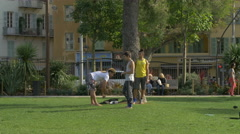 Boys doing a cartwheel in a park in Nice Stock Footage