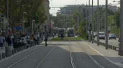 Trams and cars on a street in the city of Nice Stock Footage