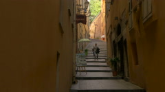 Father and son walking on a sloping street in Nice Stock Footage