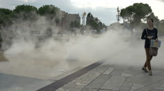 The Promenade du Paillon exhaling artificial mist on a cloudy day in Nice Stock Footage