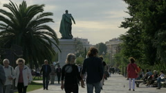Walking by the Andre Massena sculpture, on the Promenade du Paillon, Nice Stock Footage