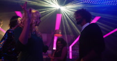 Blonde Party girl dancing with her friend at a nightclub Stock Footage