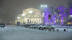 Bolshoi Theatre in the snow and led-lit park, Moscow, Russia Stock Footage