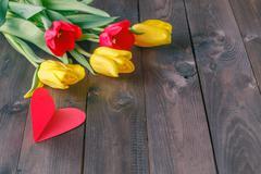 Tulip bouquet on table - stock photo