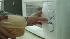 The food is heated in a microwave oven Stock Footage